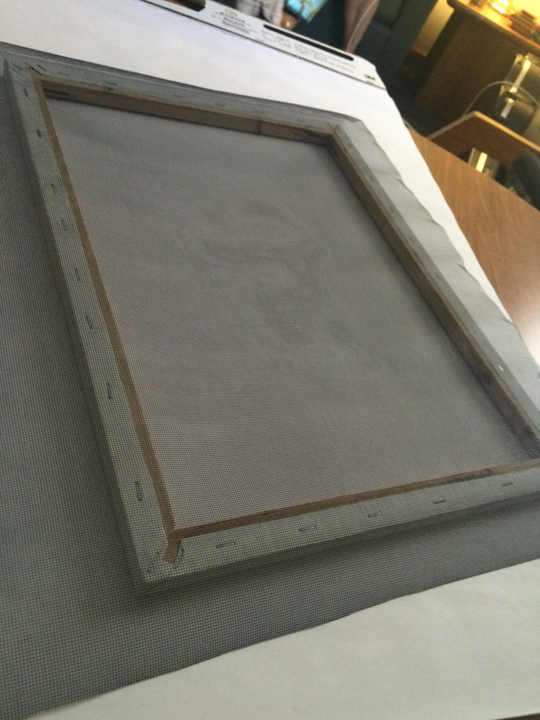 To make a deckle, we stapled a mesh screen to the frame.